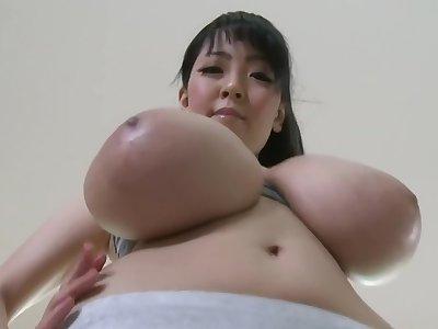 Hitomi Tanaka doing Yoga take her Huge Tits.