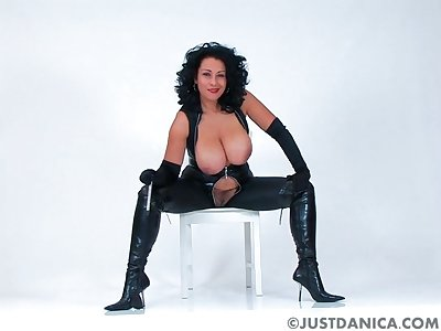 Kinky MILF Danica Collins in leather flashing say no to tits with the addition of cunt