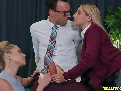 Teacher and student suck on a big dick together