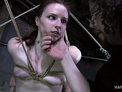 The vibrating toy goes to operate on Claire's swollent pussy in a BDSM video